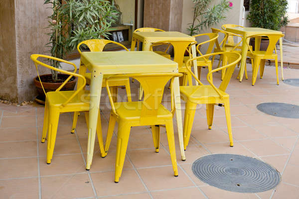 Yellow tables and chairs at outdoor restaurant Stock photo © art9858