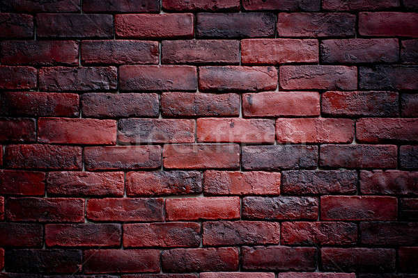 Weathered texture of stained old dark brown and red brick wall b Stock photo © art9858