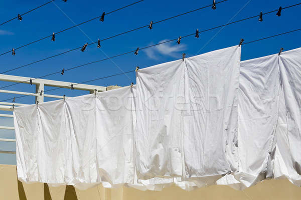 White clothes hanging on the line against blue sky. Stock photo © art9858