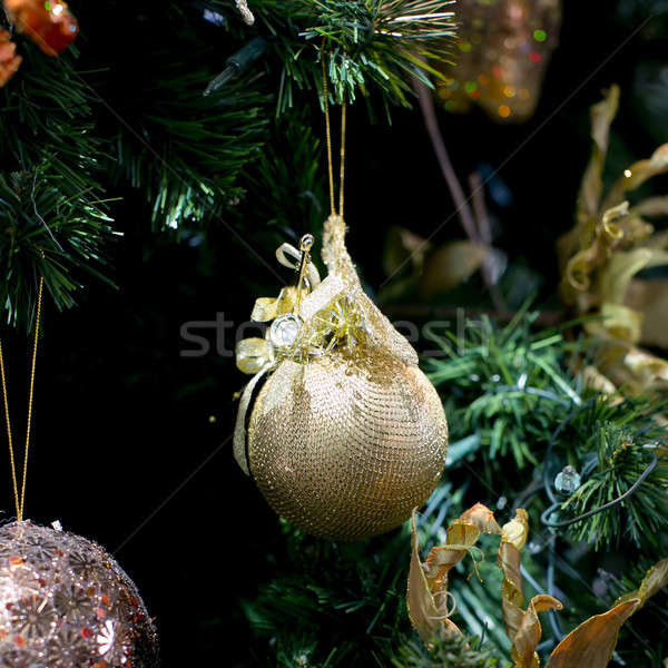 Stripy christmas ball, cristmas tree in the background Stock photo © art9858