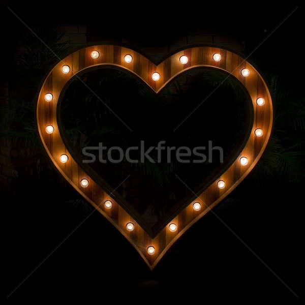 Hart teken gloeilamp zwarte licht Stockfoto © art9858
