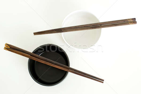 traditional empty rice bowl with bamboo chopsticks on old wood p Stock photo © art9858