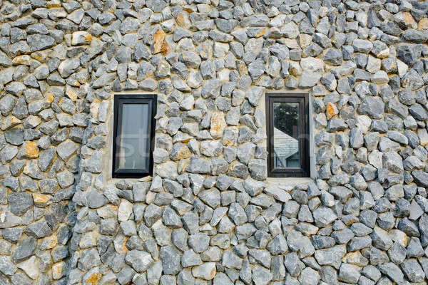 Kő fal kettő keskeny ablakok város Stock fotó © art9858