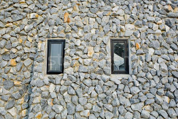 Rock wall with two narrow windows Stock photo © art9858