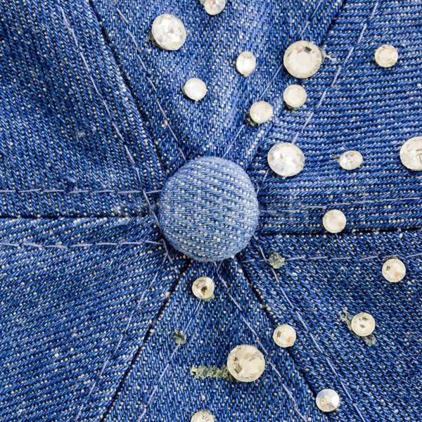 Light-blue denim with blue and silver rhinestones, background Stock photo © art9858
