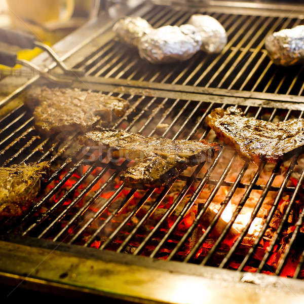 beef steak on the grill with flames Stock photo © art9858
