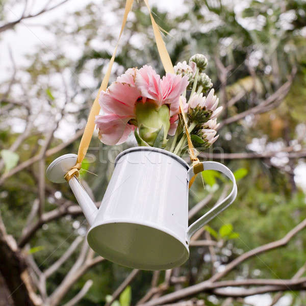 Hanging of flowers and watering can decorate in garden Stock photo © art9858