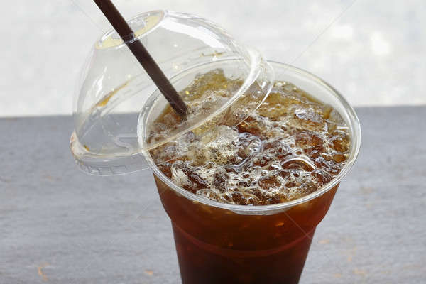 Delicious ice coffee americano with coffee glass lid and straws  Stock photo © art9858
