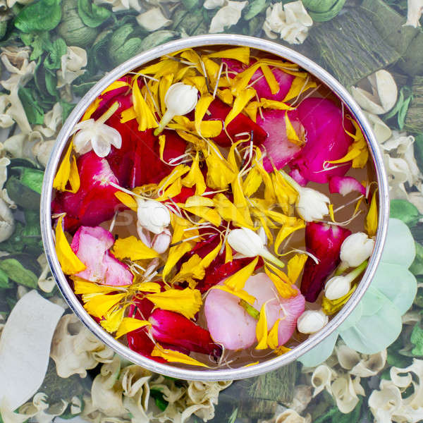 Water with jasmine and roses corolla in bowl Stock photo © art9858