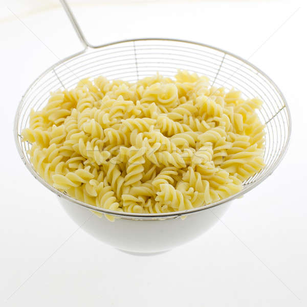 pasta fusilli in plate isolated on white background Stock photo © art9858