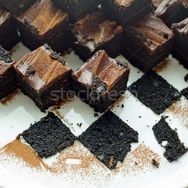 Cake chocolate brownies on white plate with leavings of brownies Stock photo © art9858