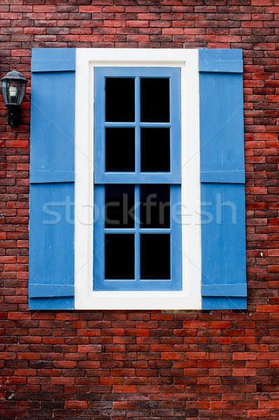 red brick with blue and white window Stock photo © art9858