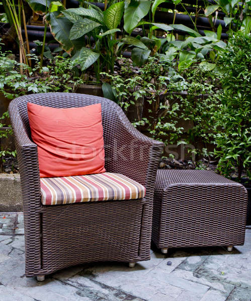 Rattan chair and rattan coffee table with green trees at outdoor Stock photo © art9858
