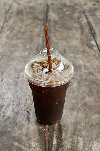 Delicious ice coffee americano on old wood table. Stock photo © art9858