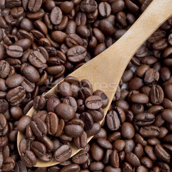 Coffee Bean scoop by wooden spoon Stock photo © art9858