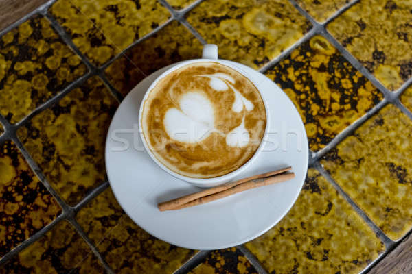 A cup of cafe latte and Cinnamon stick. Stock photo © art9858