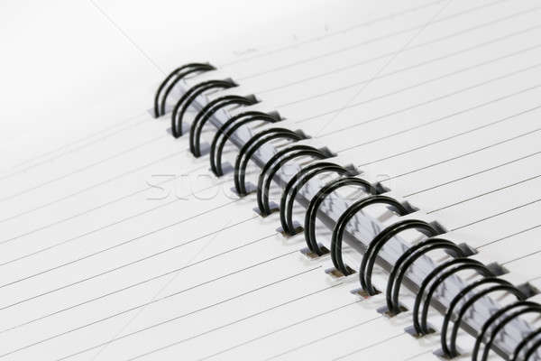 Close up of a spiral bound notebook with black spirals Stock photo © art9858
