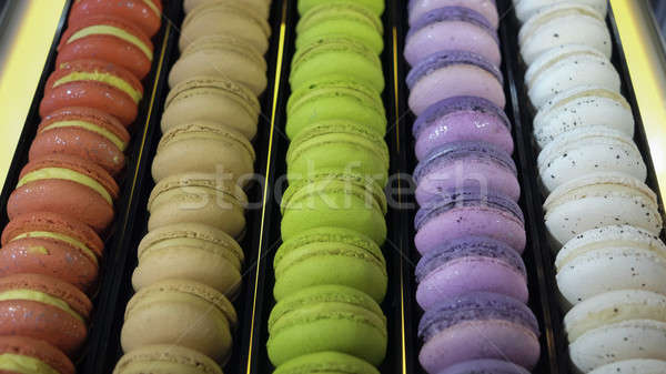 traditional french colorful macarons in a rows in a box Stock photo © art9858