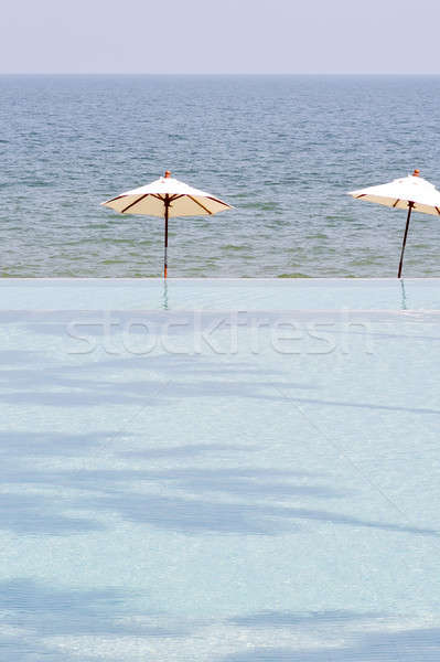 beach umbrella on a deserted beach and sea; perfect vacation con Stock photo © art9858