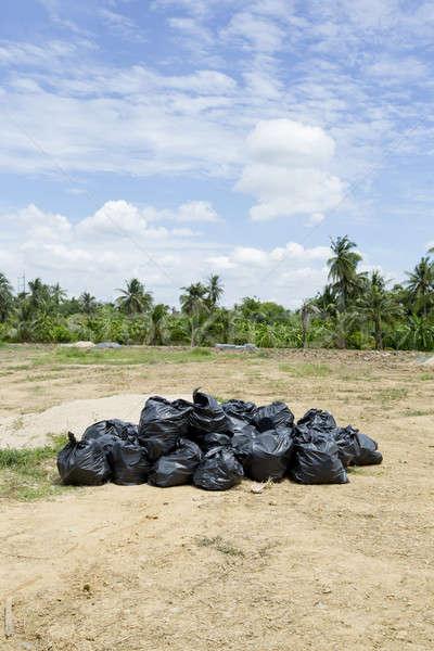 Garage dump of black trash bags. Stock photo © art9858