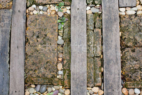 Walkway made old wood and stone on the grass Stock photo © art9858