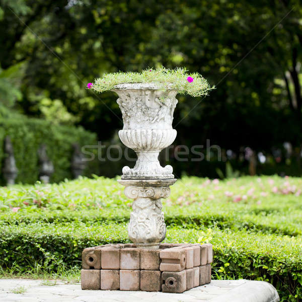 Stone planter with flowers in park Stock photo © art9858