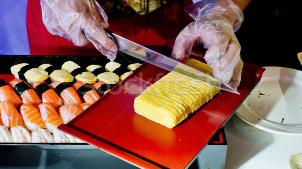 Cutting Japanese Omelette ingredient for sushi Stock photo © art9858
