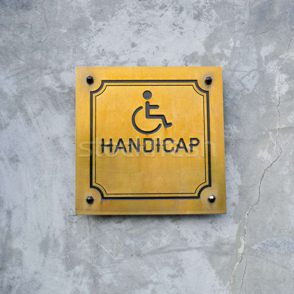Disabled Handicap Icon and wording Handicap Sign made from gold  Stock photo © art9858