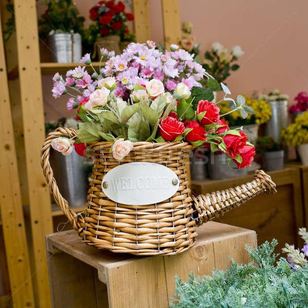 Renkli çiçekler sulama ahşap masa Paskalya ahşap Stok fotoğraf © art9858