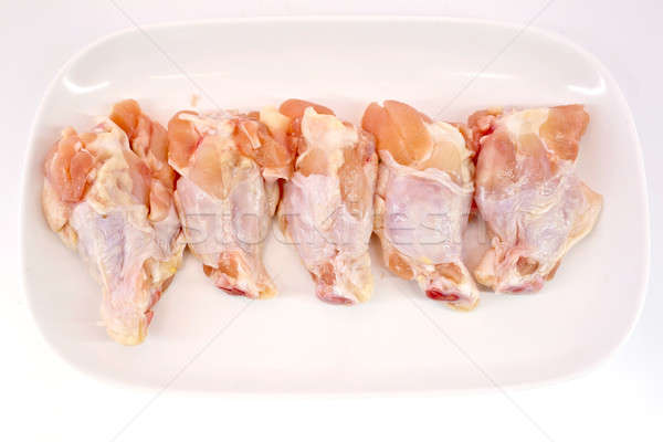 Fresh raw chicken wings isolate on white background ready to be  Stock photo © art9858