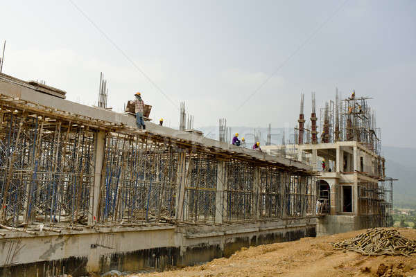 Construction site with workers on sky background Stock photo © art9858