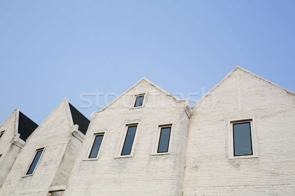 Stock photo: White cement brick block wall with a narrow window