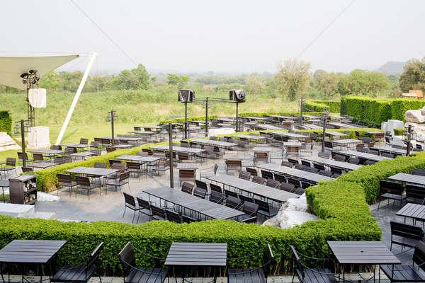 Ao ar livre tabela cadeiras vazio restaurante vidro Foto stock © art9858