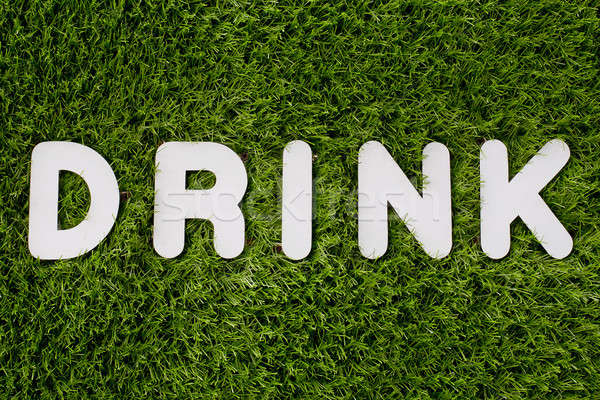 Drink text made of white wood vector design element on grass bac Stock photo © art9858