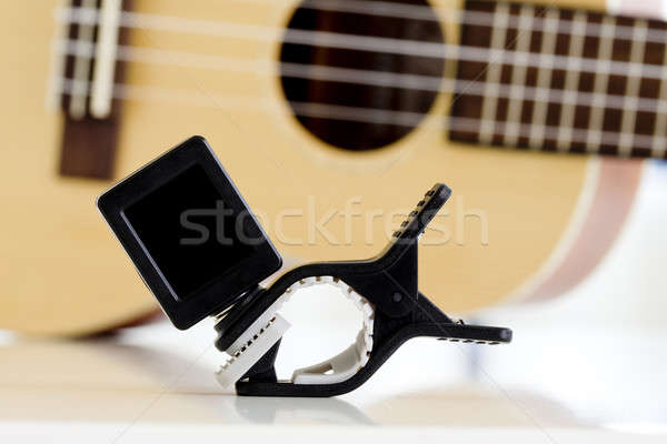 Stock photo: Clip tuner Equipment For tuning the ukulele guitar sound.