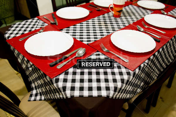 Reserved sign on a table in restaurant Stock photo © art9858