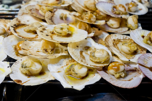 Grilled scallops topped with butter, garlic and parsley. Stock photo © art9858