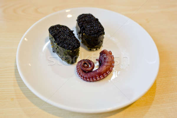 Japanese cuisine Maki Sushi with black caviar and octipus. displ Stock photo © art9858