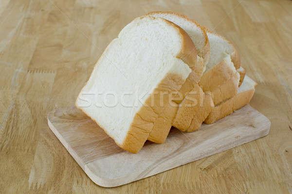 Slide bread on wooden cutting board Stock photo © art9858