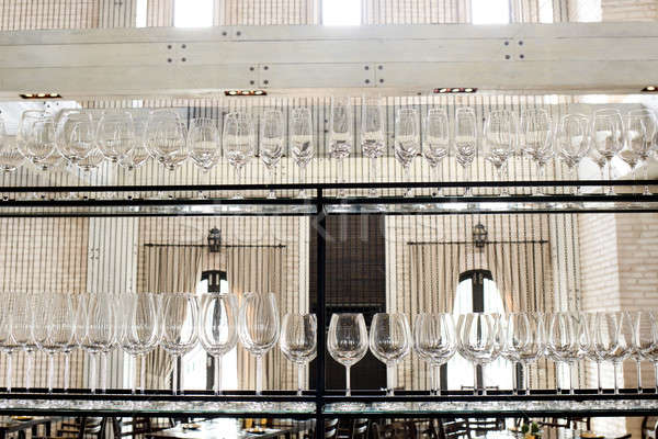 Empty glasses for wine above a bar rack Stock photo © art9858