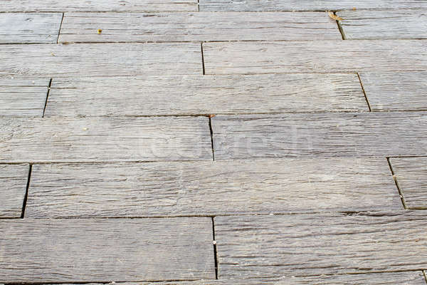 Wooden boardwalk. Weathered and rough textured Stock photo © art9858
