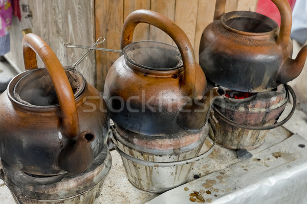 baked clay kettle with hot water on stove. Stock photo © art9858