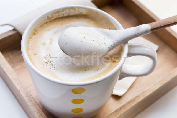 Whipping Cream on a spoon and a cup of coffee Cappuccino Stock photo © art9858