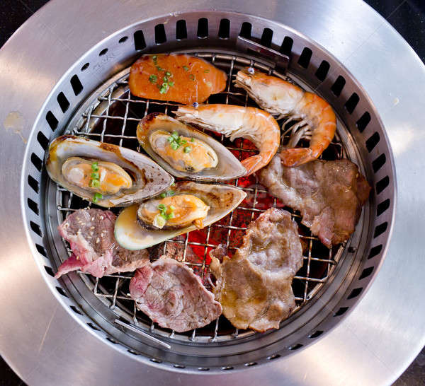Mixed Roasted Meat and Seafood on the BBQ Grill on roast. Stock photo © art9858