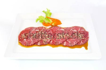 Assorted Fresh Cured Meats on white dish isolate Stock photo © art9858
