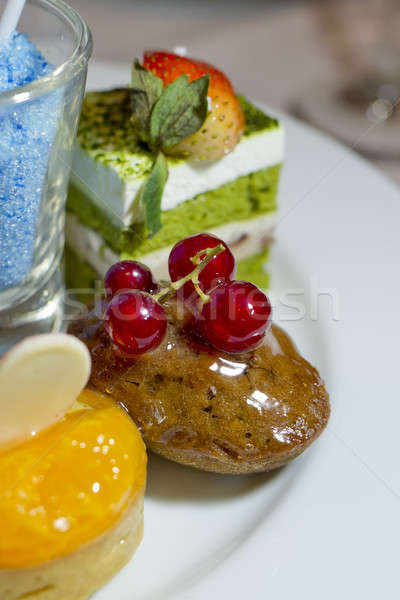 Collection of different delicious desserts and cakes in white pl Stock photo © art9858