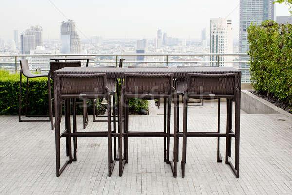 Asztal kettő zsámoly székek áll terasz Stock fotó © art9858