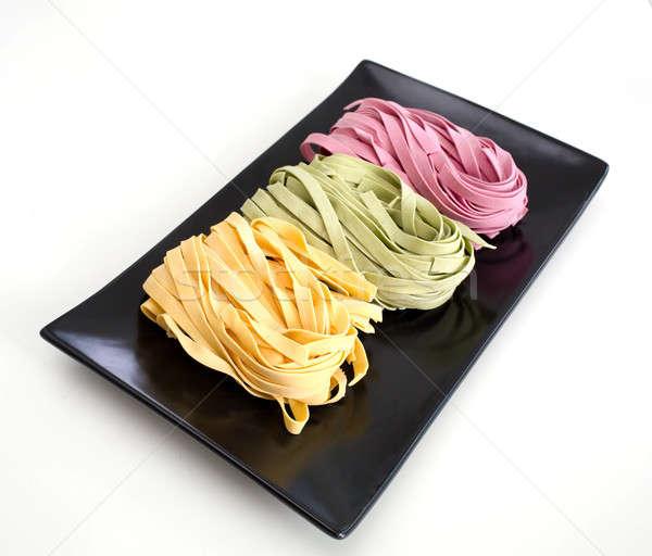 Bundles of dried ribbon color  pasta Stock photo © art9858