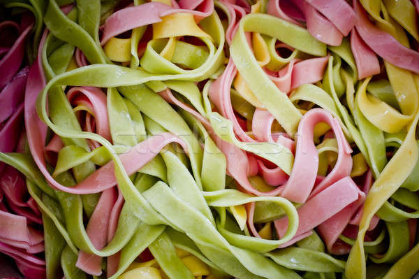 Background of colorful pasta as texture, close-up. Mixed colors  Stock photo © art9858