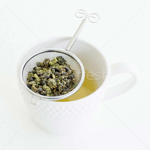 Herbal tea in a glass cup, metal sieve with dry herbal tea on a  Stock photo © art9858